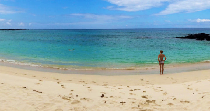 woman_alone_on_secluded_beach-1400x500